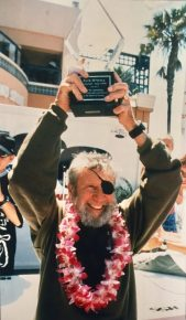 Jack O'Neill, inventor of the wetsuit, with his induction award for the Surfing Walk of Fame.