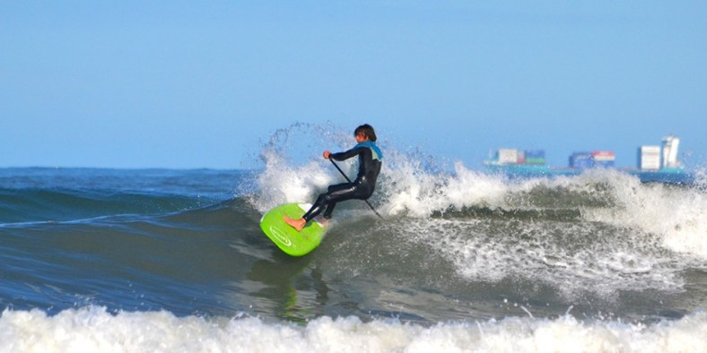 Steve throwing spray on his loco 7'4'' SUP