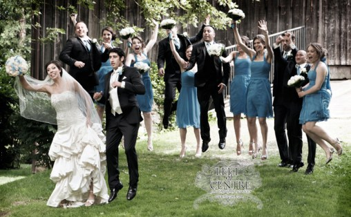 Bridal Party jumping in the air