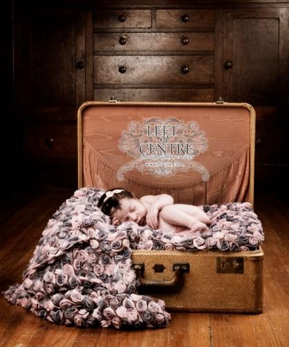 baby sleeping in suitcase