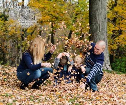 family group throwing leaves at each other