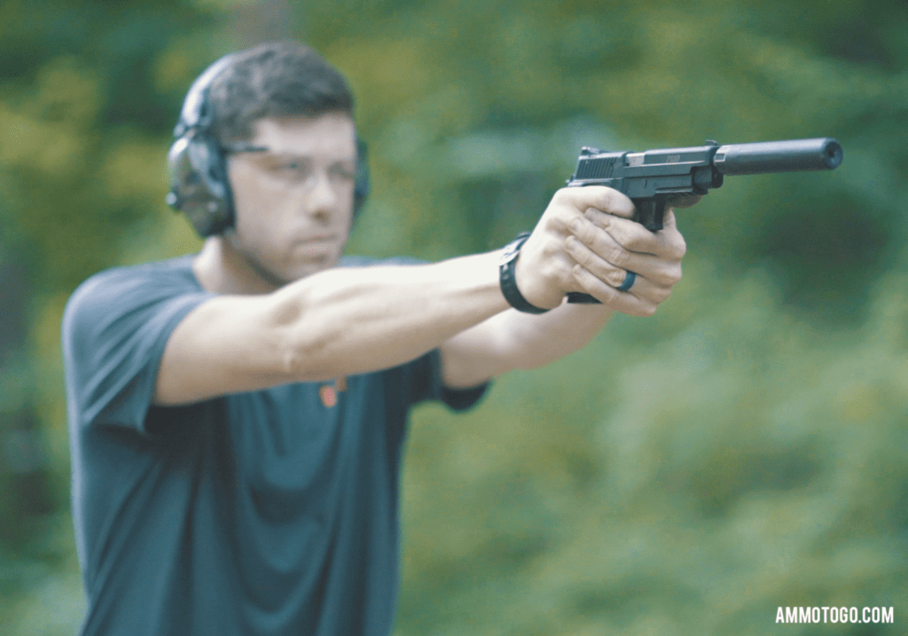 a man shooting a .22lr pistol with a silencer