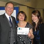 Steve Tector presents donation of £352 to Chris Doolan and Laura Kemp of Birmingham Settlement