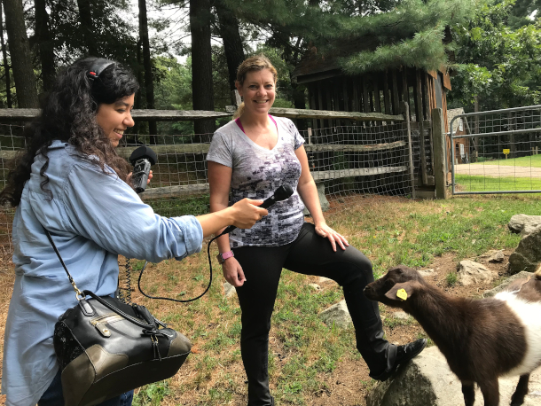 Aynsley O'Neill and Michelle Aullson with a goat