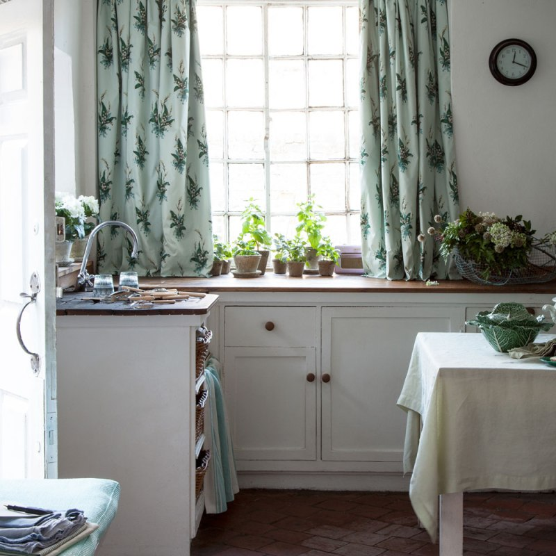 Kitchen with floral green curtains