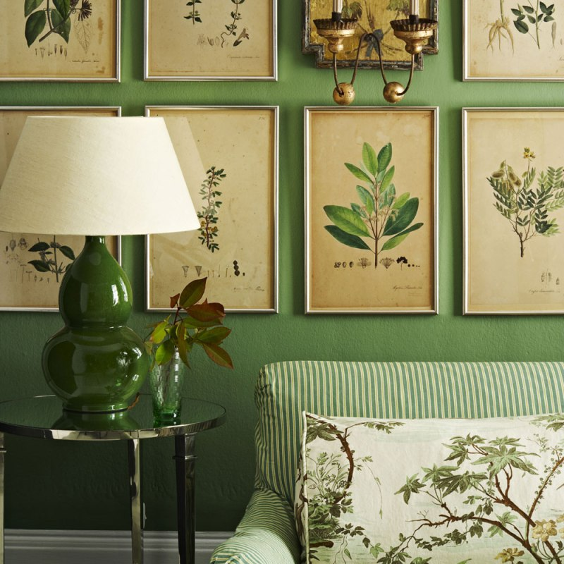 green living room with striped fabric and botanical prints