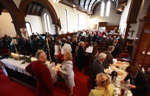 The congregation of over 170 enjoy a tradition Sunday Tea.