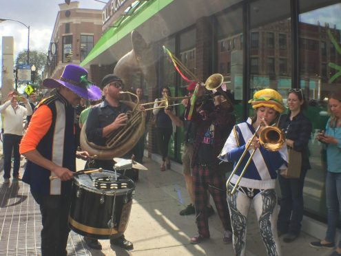 Musicians played at the opening of the Co-op, complete with funny costumes a diverse instruments.
