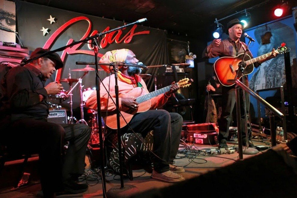 Photo of blues performers playing on stage at Rosa's Lounge