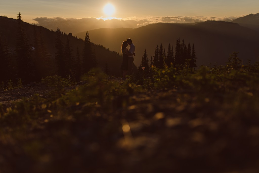 sunset engagement couple silhouette on whistler blackcomb
