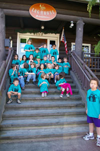 tours: kids outside of the loghouse