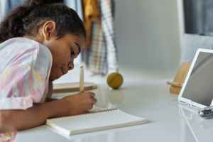 Young Girl Working on Distance Learning Class