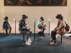 People Using Virtual Reality at a Museum