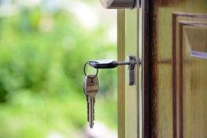Key in door in front of a green background