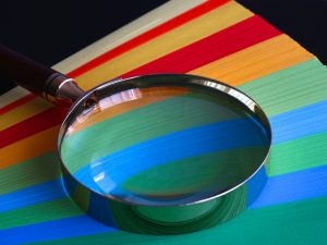 Magnifying Glass on Rainbow Paper