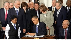 Obama Signs Affordable Care Act