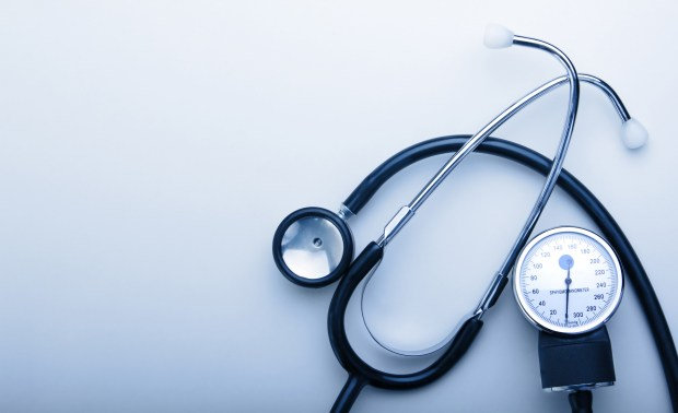 stethoscope on blue background with space for simple text