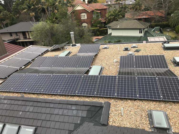 A picture of solar panels installed on a flat roof by Lokic Energy Solutions