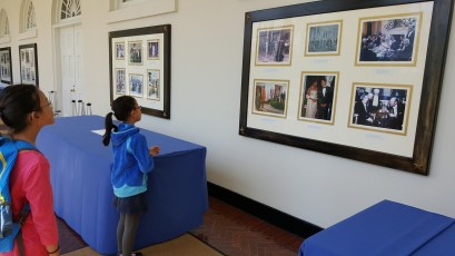 We're looking at the photos of current and past presidents on the wall in the East Colonnade.