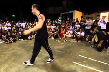 Miúdo desafia dançarino de break dance
