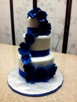 """""""Malia"""" Morning glory inspired, this cake features deep blue gumpaste flowers and blue satin ribbon."""
