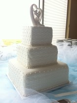 Quilted white on white wedding cake