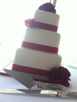 """""""Holly"""" 3 tier wedding cake with quilted pattern, pearls, & red roses. Feeds 100. MSRP $435"""