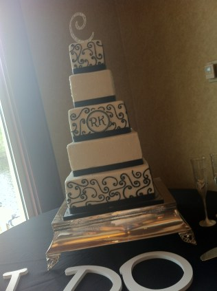 """""""Kristin"""" 5 tier black and white wedding cake with scrolls and monogram"""