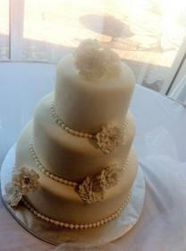 """""""Soyong"""" White on white wedding cake with gumpaste flowers"""