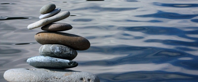 A stack on stones tilted precariously by the river side