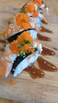 """""""Tiger Roll"""": Prawn over a crab stick roll with some sweet/salty sauce to the side"""