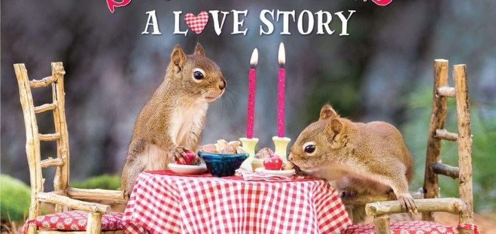 Squirrels eating at a table with candles.