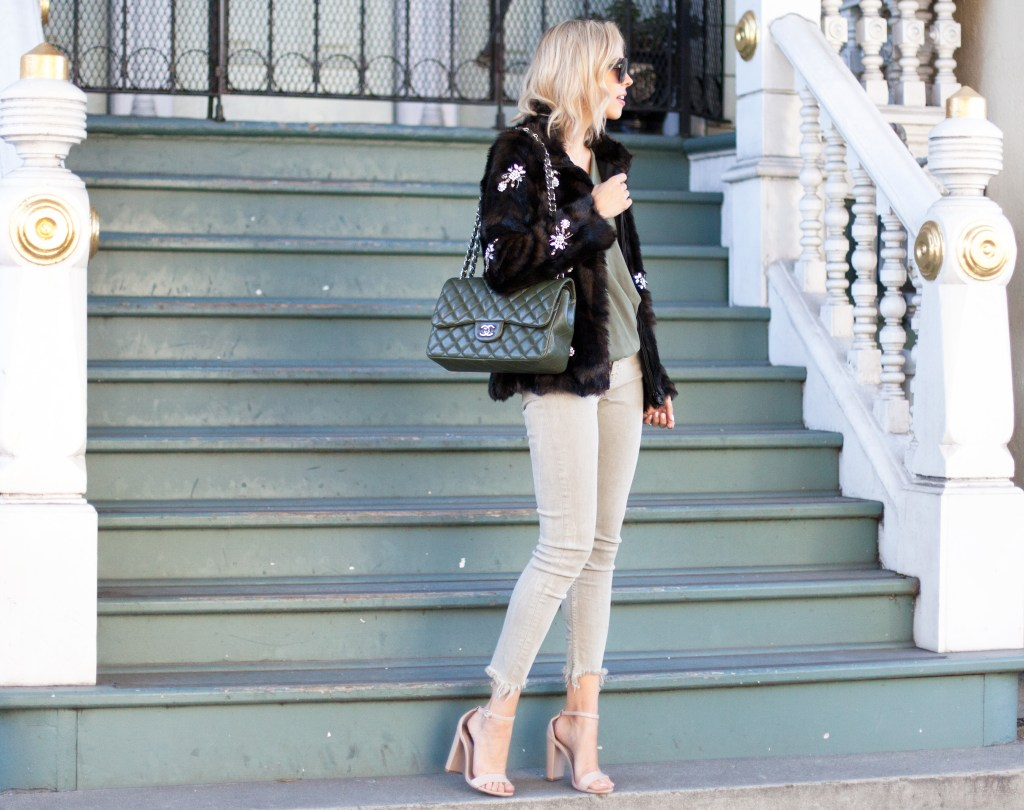 olive chanel jumbo flap bag zara faux fur jacket | Chanel flap bag featured by The-Collectory featured by top US fashion blog, Lombard and Fifth: image of a woman wearing a Zara bejeweled jacket, Zara skinny jeans.