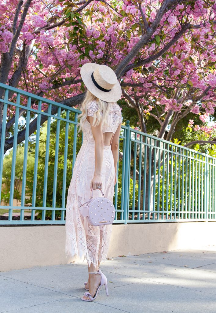 Foxiedox lace dress, star mela boater straw hat, poppy & peonies circle bag, cherry blossoms