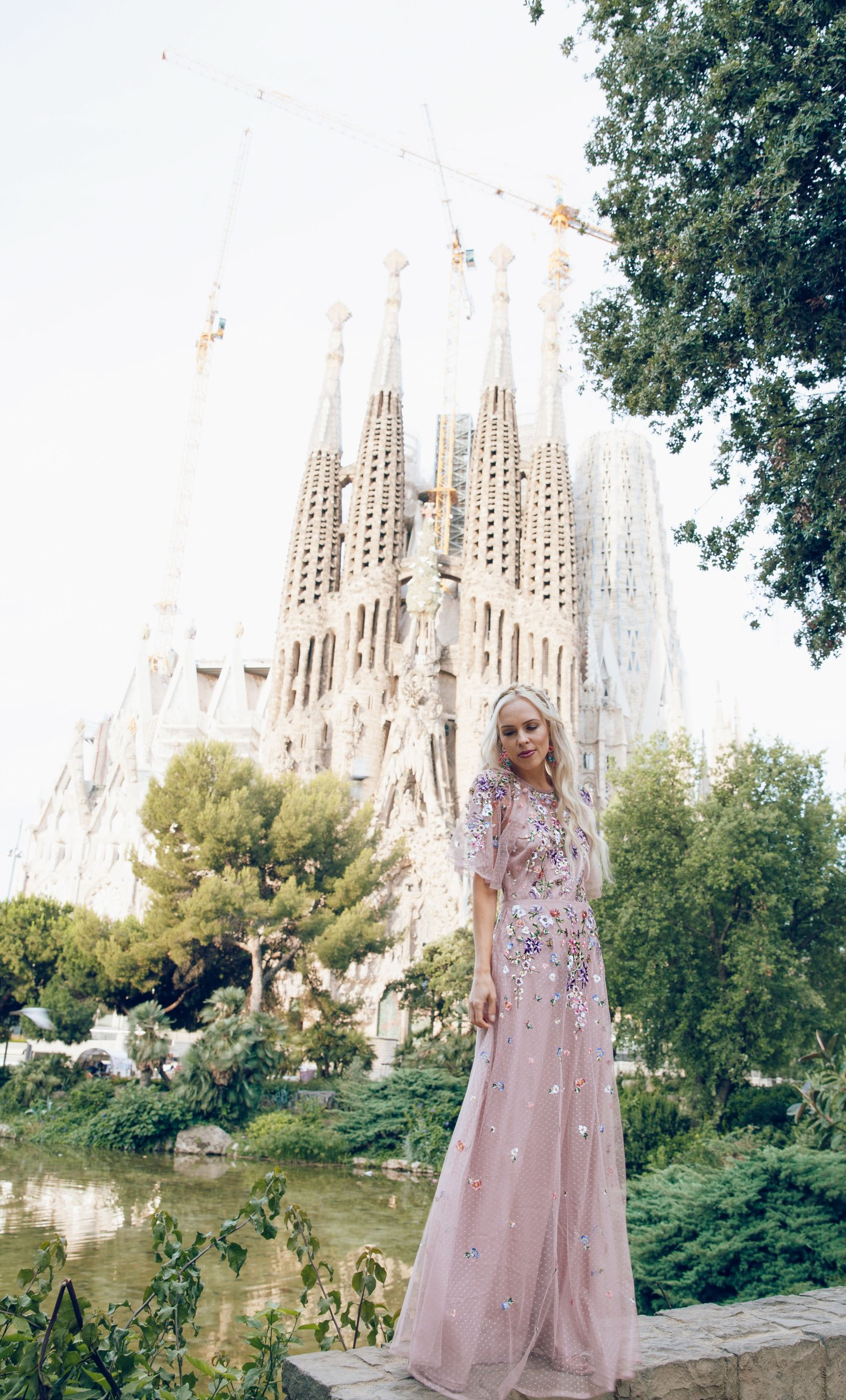 ASOS DESIGN Bridesmaid floral embroidered dobby mesh flutter sleeve maxi dress in barcelona | ASOS floral embroidered maxi dress featured by top San Francisco fashion blog, Lombard and Fifth: image of a blonde woman wearing a floral maxi dress at the Colosseum in Rome