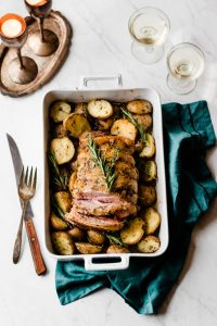 Colorado Lamb leg roast with herbed garlic butter potatoes