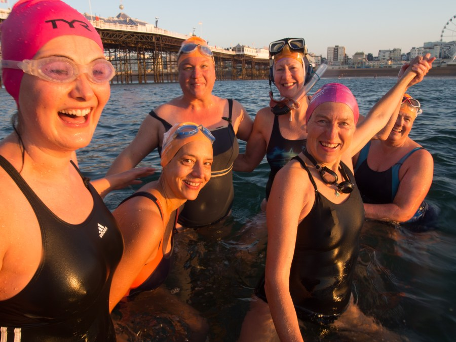 Ladies of Brighton Swimming Club standing on a sunken barge