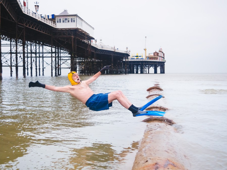 Dave Sawyers jumping off victorian sewer pipe at low tide