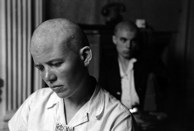 Women with Shaved head accused of being a collaborator by Lee Miller