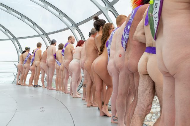 Naked cyclists taking in the view on the British Airways I360