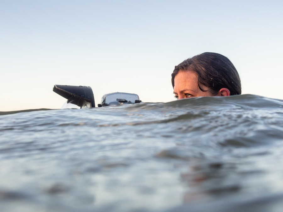 Emma Critchley in the water with camera by Kevin Meredith