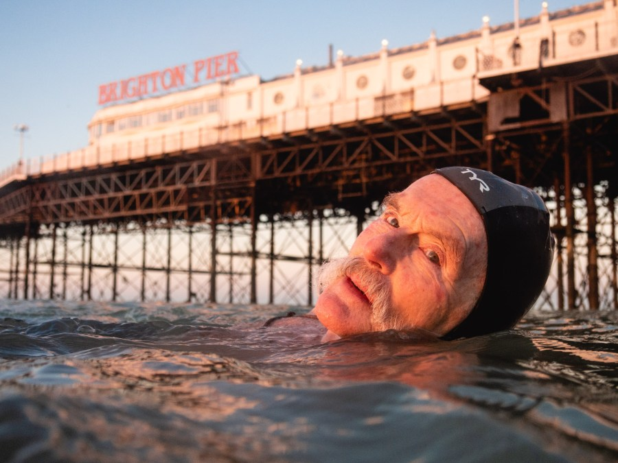 Dave swimming by Brighton Pier