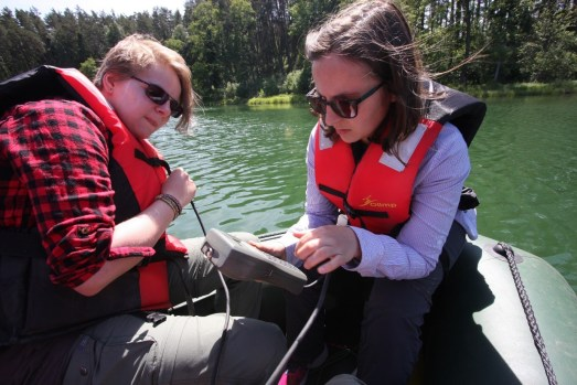 Marie-Luise Adolph (left) and Rachel Devine (right) at Lake Głęboczek conducting lake water measurements such as temperature, conductivity, pH and Dissolved Oxygen (DO). Image copyright Rachel Devine.