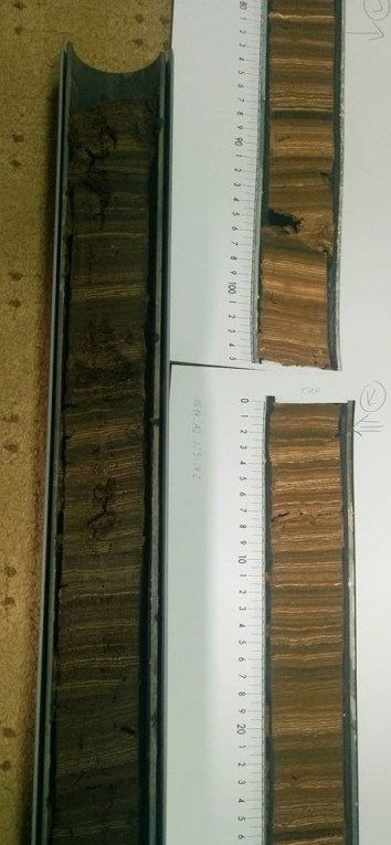 Varved sediment core from Lake Głęboczek (top) with high resolution image (bottom). Image copyright Rachel Devine.