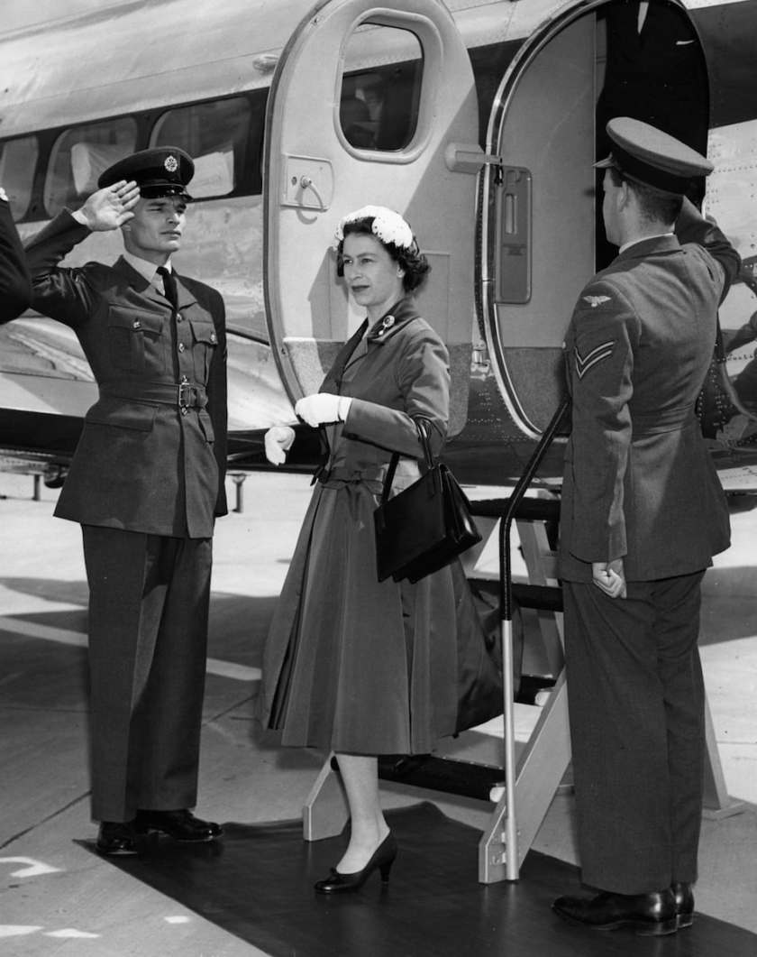 Queen Elizabeth II steps from a Heron of the Queen's Flight on her arrival at the new Gatwick Airport, for its official opening on 9 June 1958.