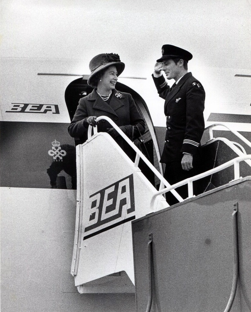 Her Majesty The Queen Elizabeth II disembarking from a BEA Trident aircraft following a State Visit to Turkey, 1972. Steward Bob Godfrey bids farewell to Her Majesty.