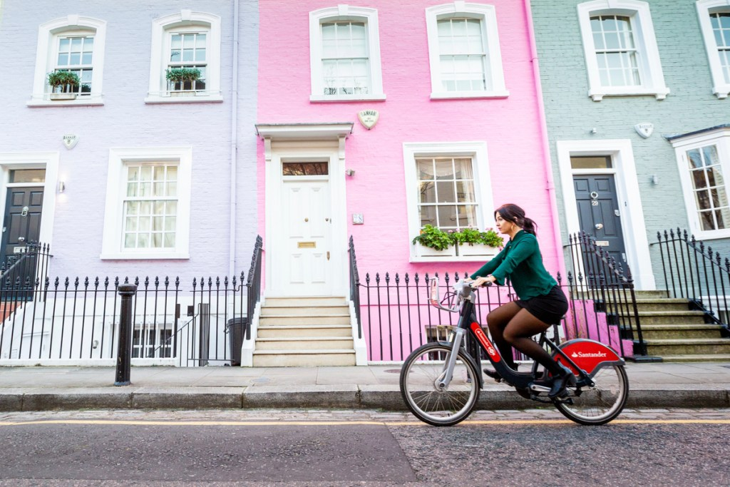 Girl riding a Santander Cycles in Chelsea London