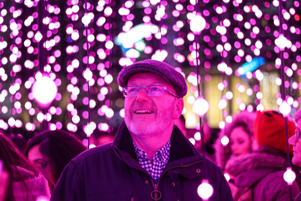 Man enjoying Canary Wharf Winter Lights festival