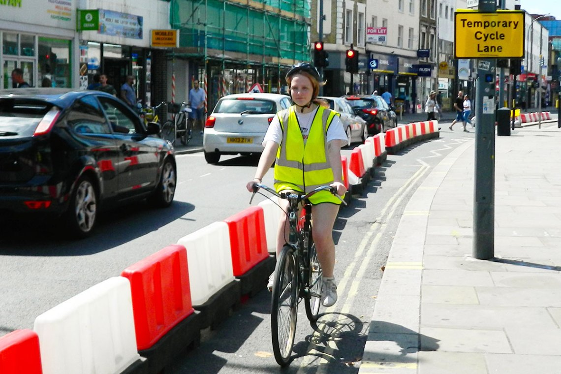 girl cycling along streetspace cycle lane