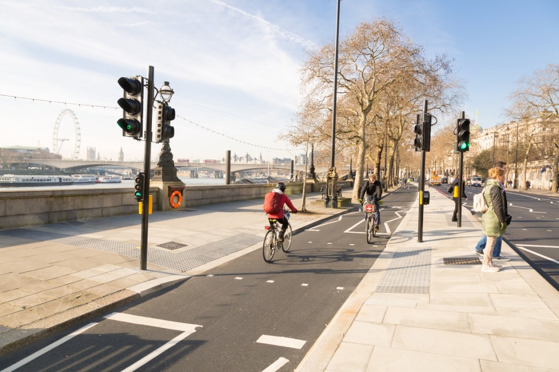 Cyclists in a cycle lane alongside the River Thames